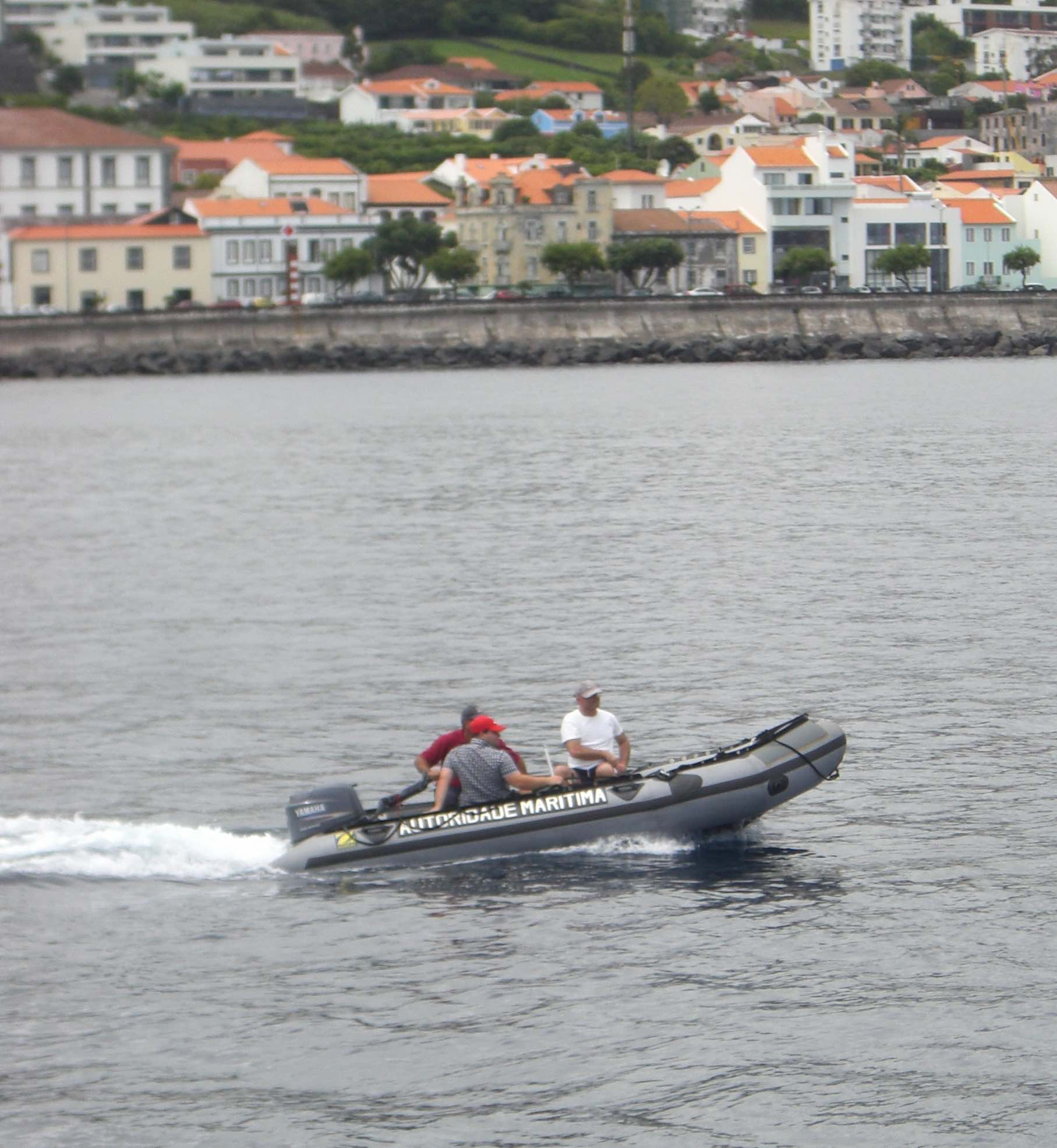 Heading out of the harbor to test an LAUV, João Tasso and Bruno on a Maritime Police RHIB.